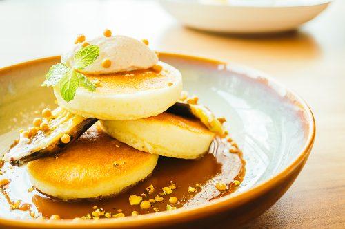 Sweet dessert pancake with banana and sweet sauce