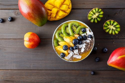 Peach smoothie bowl with kiwi fruit